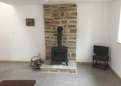Wood stove installation in the lounge