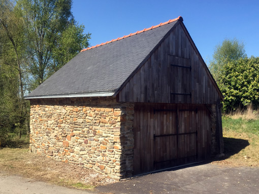 garage constructed with stones and wood