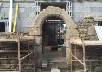 Construction of the front door using original stone