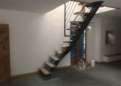 Laying floor tiles and staircase installation