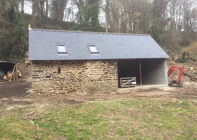 Outbuilding and wood store near completion